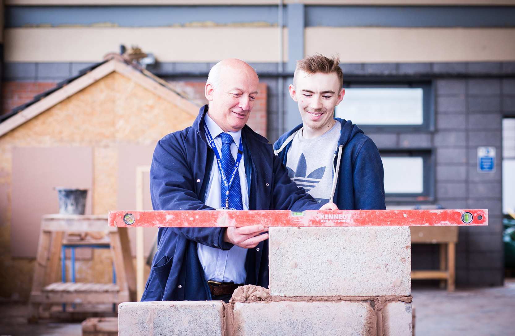 Learner and teacher using a spirit level.