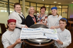 Charity donation from catering students
